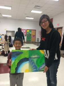 """At Moorefield Station Elementary School, this mom and her son beam when presenting their """"My Masterpiece with My Parent"""" art!"""