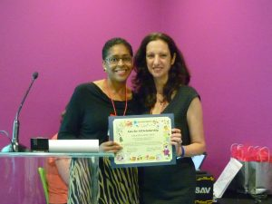 Charla Stuart (left) accepts Abrakadoodle's Arts for All Scholarship Award at Conference 2015.