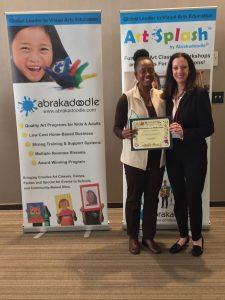 Media Star Dawna Kelly accepts her Abrakadoodle in the Media Award from Rosemarie Harnett.