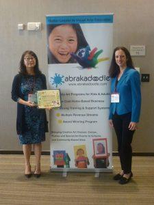 Alice Wang, CEO of Abrakadoodle, representing China, accepted the International Purple Tree Award.