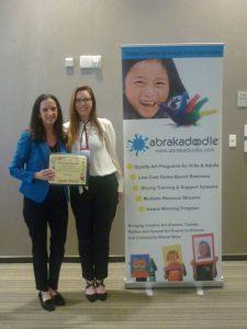 Rosemarie Hartnett, President of Abrakadoodle presents Arts for All Award to Margaret Cornwell.