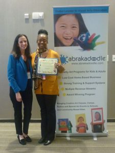 Rosemarie Hartnett honors Dawna Kelly with Community Service Award.