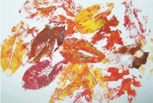 Dip the shells or leaves in paint. Press and print them on paper leaving texture marks.