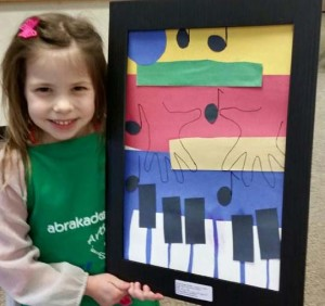 Young Abrakadoodle student in Georgia proudly shows her art inspired by Leonor Brazao.