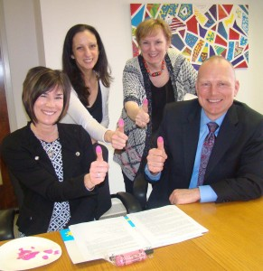 """: It's thumbs-up in Crayola color """"Tickle Me Pink"""" for Eileen and Troy Moore (seated) with Abrakadoodle founders and managing executives Rosemarie Hartnett and Mary Rogers."""