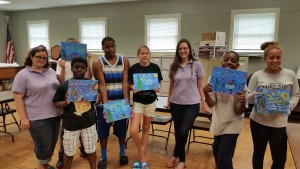 """Some residents of the Brantwood Children's Home show off their Van Gogh-inspired """"Starry Night"""" creations."""