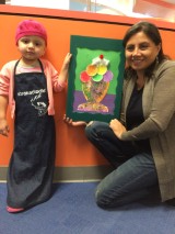 A little girl takes a break from fighting cancer to create art.
